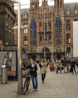 Joan in front of the Magna Plaza Shopping Center Amsterdam